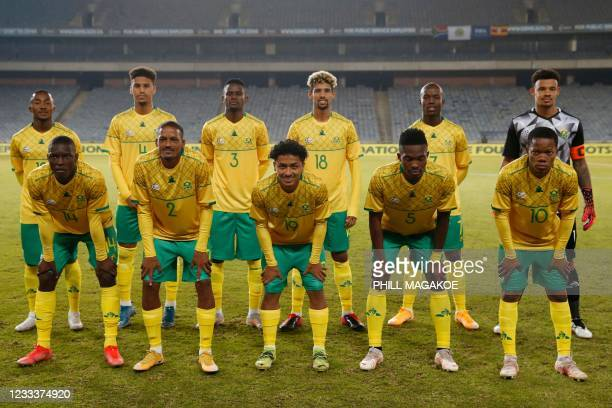The South African team pose for a photograph ahead of the International friendly football match between South Africa and Uganda at the Orlando...