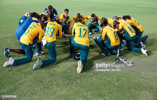 The South African team pray after the match during the Women's ICC World Twenty20 India 2016 Group A match between Australia and South Africa at the...