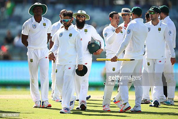 The South Africans walk from the field after defeating Australia during day five of the First Test match between Australia and South Africa at the...