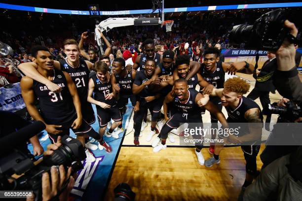 The South Carolina Gamecocks celebrate defeating the Duke Blue Devils 8881 in the second round of the 2017 NCAA Men's Basketball Tournament at Bon...