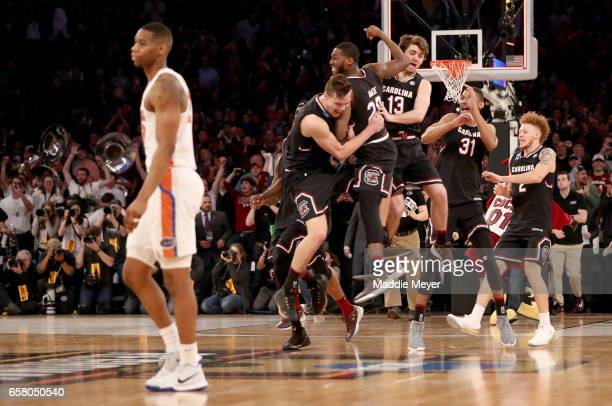 The South Carolina Gamecocks celebrate defeating the Florida Gators with a score of 77 to 70 to win the 2017 NCAA Men's Basketball Tournament East...
