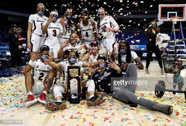 The South Carolina Gamecocks celebrate the win over the Texas Longhorns to advance to the Final Four during the Elite Eight round of the NCAA Women's...