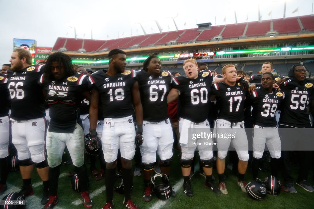 The South Carolina Gamecocks celebrate their 26-19 win over the Michigan Wolverines at the Outback Bowl NCAA college football game on January 1, 2018 at Raymond James Stadium in Tampa, Florida.