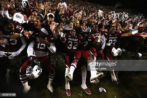 The South Carolina Gamecocks celebrate with students after a 31-17 victory over the Clemson Tigers after their game at Williams-Brice Stadium on...