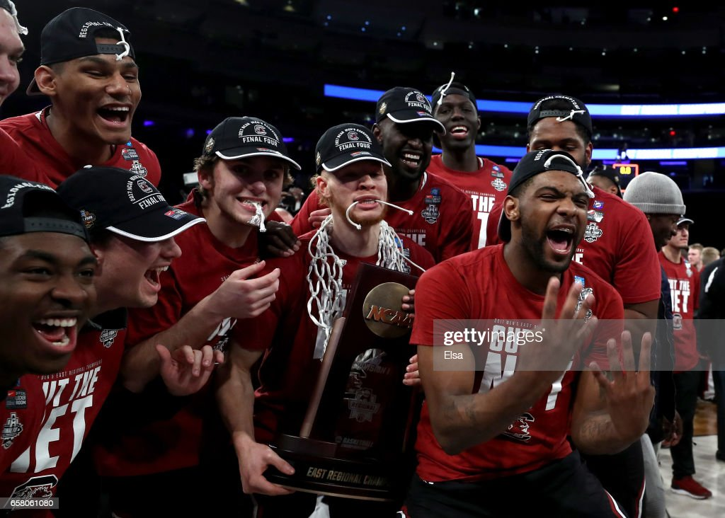 The South Carolina Gamecocks celebrate with the their trophy after defeating the Florida Gators with a score of 77 to 70 to win the 2017 NCAA Men's Basketball Tournament East Regional at Madison Square Garden on March 26, 2017 in New York City.