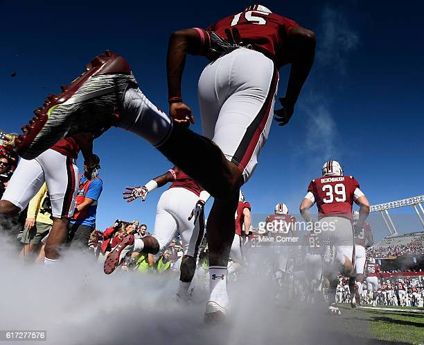The South Carolina Gamecocks take the field for their game against the Massachusetts Minutemen at WilliamsBrice Stadium on October 22 2016 in...