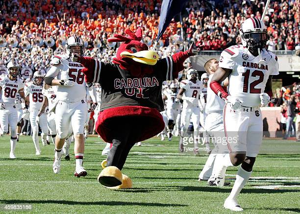 The South Carolina mascot runs out on the field prior to their game against the Clemson Tigers at Memorial Stadium on November 29 2014 in Clemson...