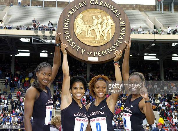 The South Carolina women's 4 x 100meter relay Shalonda Solomon Amberly Nesbitt Alexis Joyce and Erica Whipple hold championship plaque after winning...