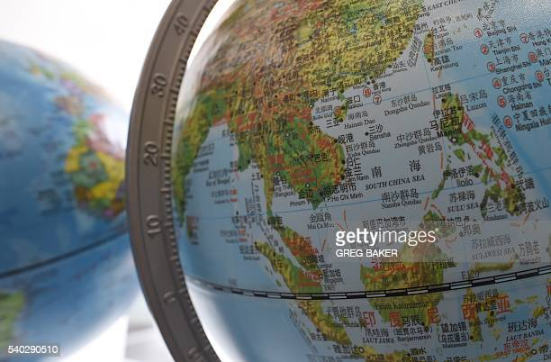 The South China Sea is seen on a globe for sale at a bookstore in Beijing on June 15 2016 Indonesia said June 15 that a bold statement from Southeast...