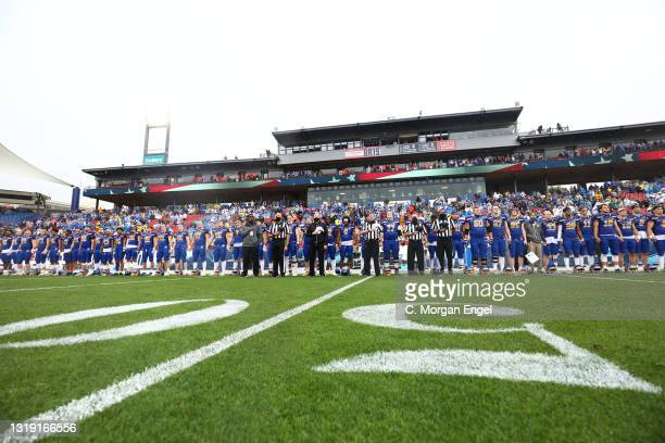 The South Dakota State Jackrabbits hold hands during the national anthem before the game against the Sam Houston State Bearkats during the Division I...