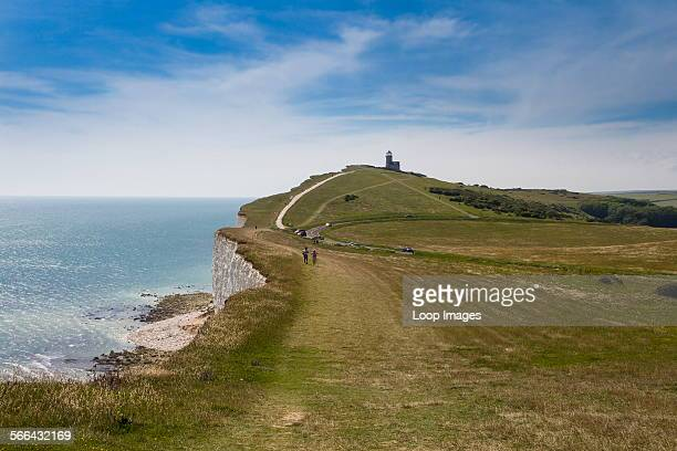 The South Downs Way up Beachy Head with Belle Tout Lighthouse in the distance