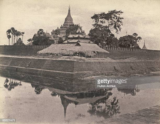 The south east corner of the city wall and moat which surrounds Amarapura Burma 1854