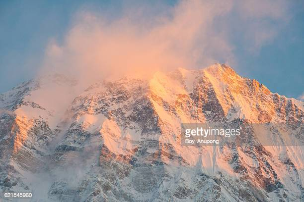 The south face of Annapurna I during the sunrise in the morning.