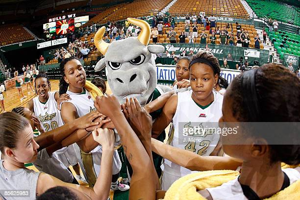 The South Florida Bulls celebrate their victory in the Women's National Invitational Tournament game over the Mississippi Rebels at the USF Sun Dome...
