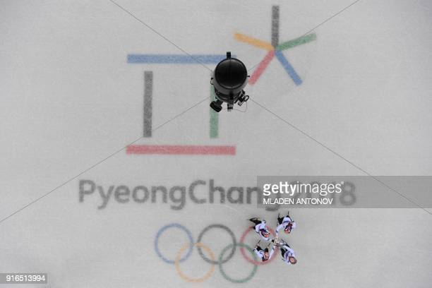 The South Korea team reacts after winning the women's 3,000m relay short track speed skating heat event during the Pyeongchang 2018 Winter Olympic...