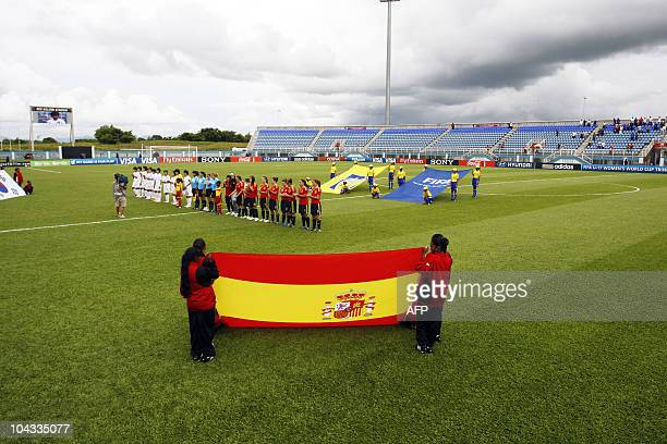 The South Korean and Spanish players stand in the field before for the beginning of the FIFA Women's Under-17 semifinal match against Spain on...