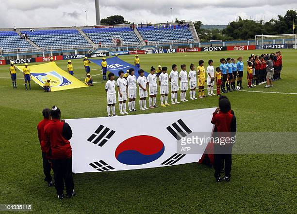 The South Korean and Spanish players stand in the field before for the beginning of the FIFA Women's Under17 semifinal match on September 21 at the...