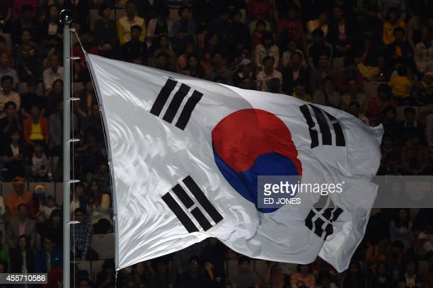 The South Korean flag flies during the opening ceremony of the 2014 Asian Games at the Incheon Asiad Main Stadium in Incheon on September 19 2014 AFP...