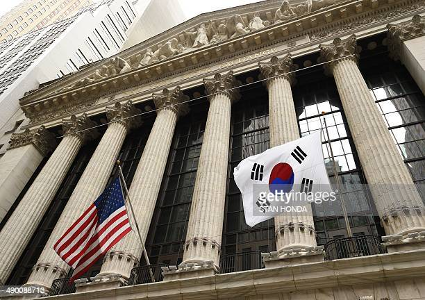 The South Korean flag flies with a US flag outside the New York Stock Exchange before South Korea's Ambassador to the US Ahn HoYoung rang the opening...