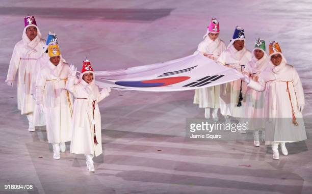 The South Korean flag is carried into the stadium during the Opening Ceremony of the PyeongChang 2018 Winter Olympic Games at PyeongChang Olympic...