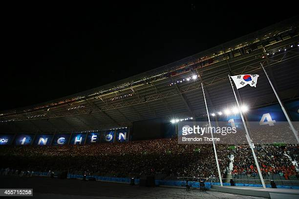 The South Korean flag is raised during the Opening Ceremony ahead of the 2014 Asian Games at Incheon Asiad Main Stadium on September 19 2014 in...