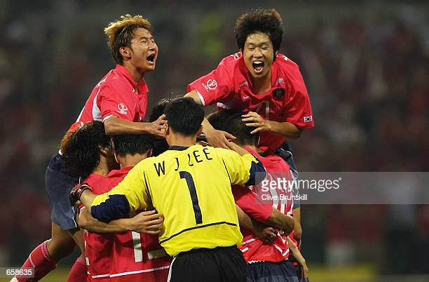 The South Korean players celebrate winning the Group D match against Poland at the World Cup Group Stage played at the Asiad Main Stadium Busan South...