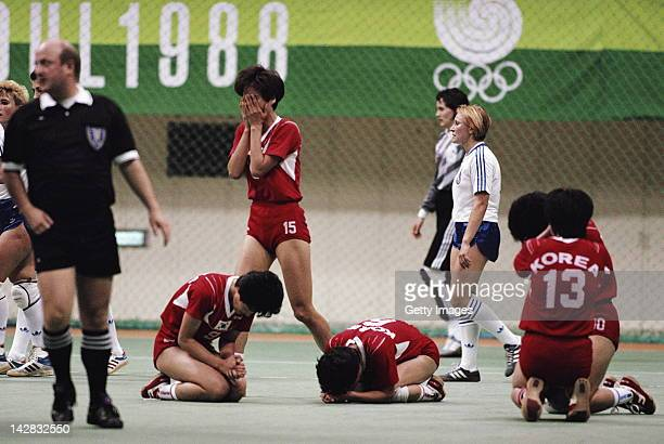 The South Korean team is overcome with emotion after defeating the USSR in the final round match of the Women's Handball competition to win the gold...