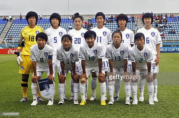 The South Korean team poses before the beginning of the FIFA Women's Under17 semifinal match against Spain on September 21 at the Ato Boldon Stadium...