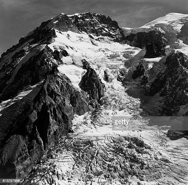 The South Mowich Glacier on Mount Rainier's west side flows over rocky ridged areas which stress and fragment the glacier's surface Washington...