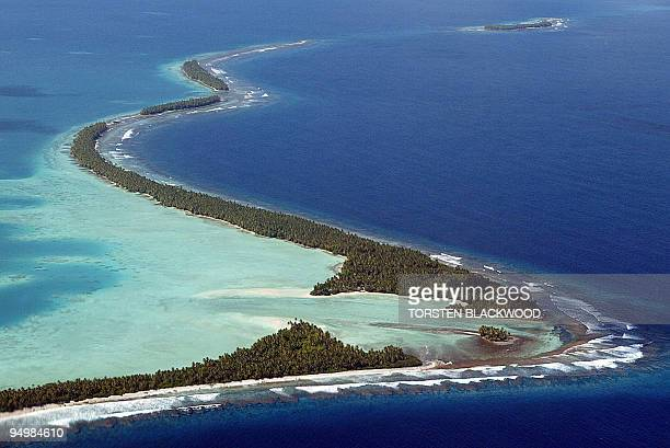 The South Pacific pounds the serpentine coastline of Funafuti Atoll 19 February 2004 home to nearly half of Tuvalu's entire population of 11 as king...