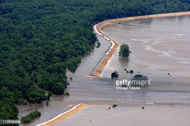 The south portion of the Indian Graves levee is breached by flood waters near Quincy Illinois Wednesday June 18 2008