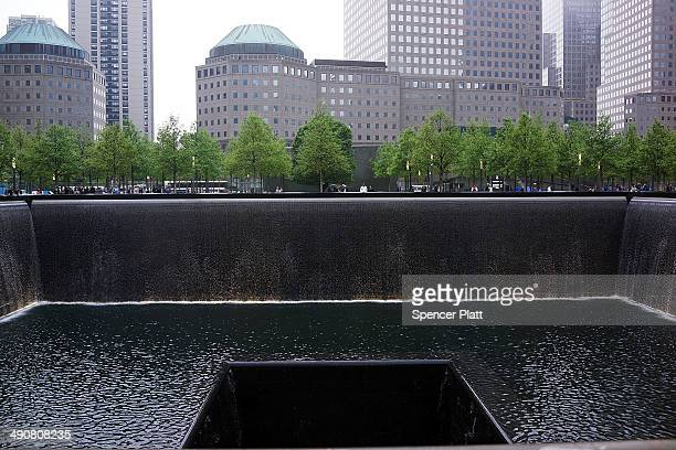 The South reflecting pool is viewed at the Ground Zero memorial site during the dedication ceremony of the National September 11 Memorial Museum in...