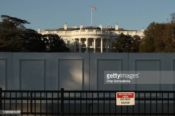 The south side of the White House is seen behind layers of fencing less than 24 hours before Election Day November 02 2020 in Washington DC Extra...
