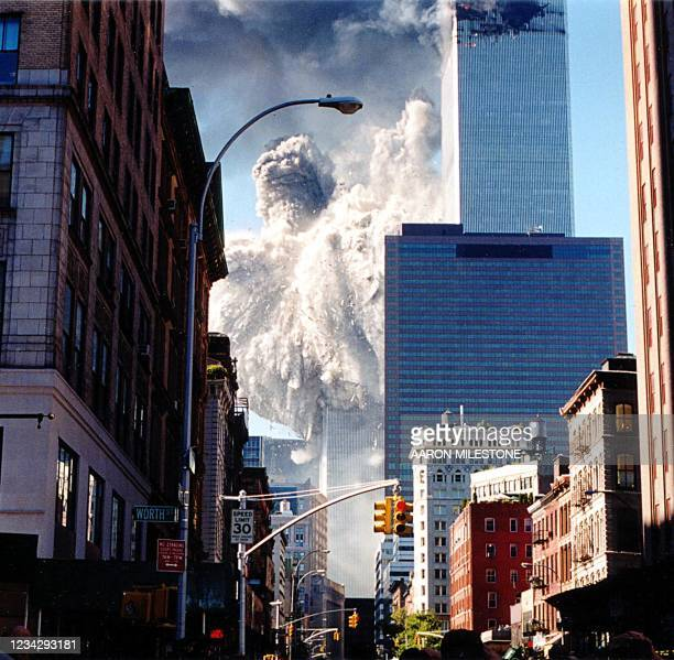 The south tower of the World Trade Center collapses sending dust and smoke into the streets 11 September in New York. Two planes crashed into the...