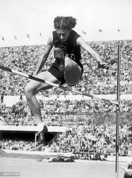 The SouthAfrican Esther BRAND highjumping at the Olympic Stadium of Helsinki during the Olympic Games in August 1952 She won the event with a jump of...
