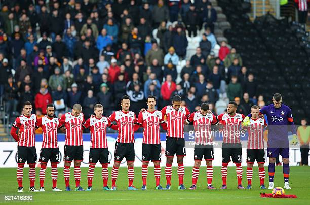 The Southampton players take part in a minutes silence in honour of Remembrance Day prior to the Premier League match between Hull City and...