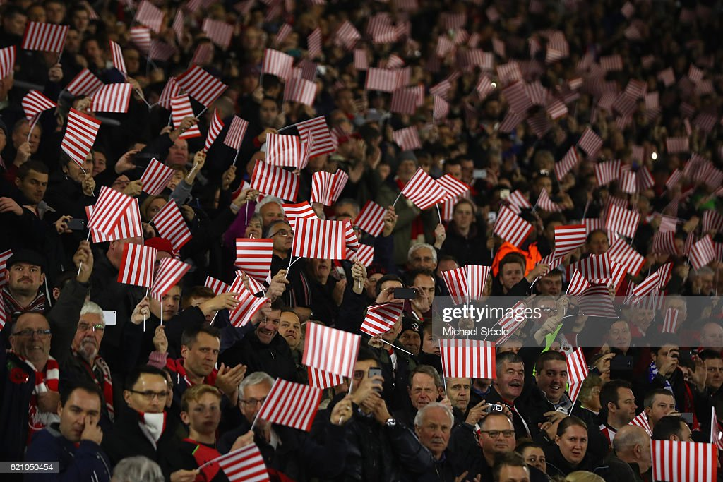 The Southampton supporters wave flags in the ir teams colours ahead of the UEFA Europa League match between Southampton FC and FC Internazionale Milano at St Mary's Stadium on November 3, 2016 in Southampton, England.