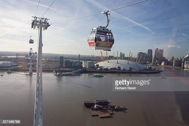 The southbound view from a gondola on a journey over the River Thames on the Emirates Cable Car from Royal Docks towards the o2 arena on the...
