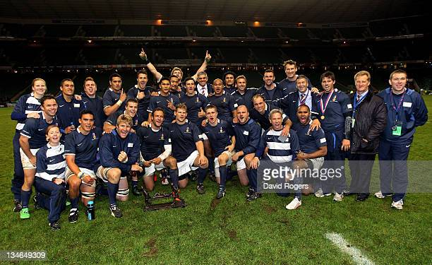 The Southern Hemisphere XV celebrate following their victory during the Help For Heroes Rugby Challenge match between the H4H Northern Hemisphere XV...