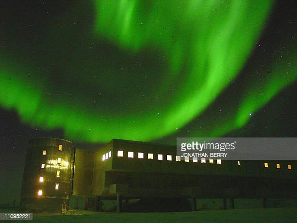 The southern lights, over the geodesic dome at the National Science Foundation's Amundsen-Scott South Pole station, 22 May 2002. The aluminium dome...