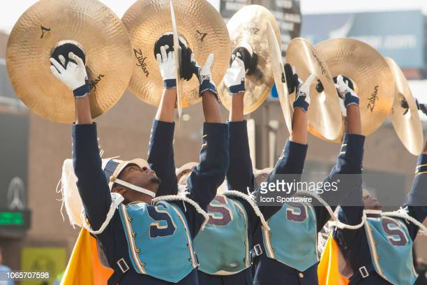 """The Southern University """"Human Jukebox"""" cymbal section perform flashes while marching toward the Super Dome during the 45th annual State Farm Bayou..."""