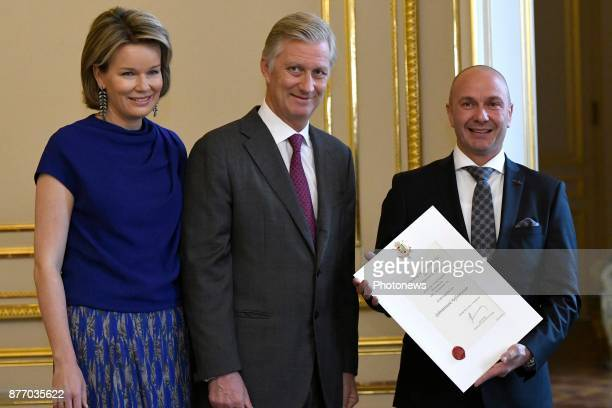The Sovereigns meet the new providers of the Court Queen Mathilde and King Philippe pictured with Frank Vanpraet during the ceremony