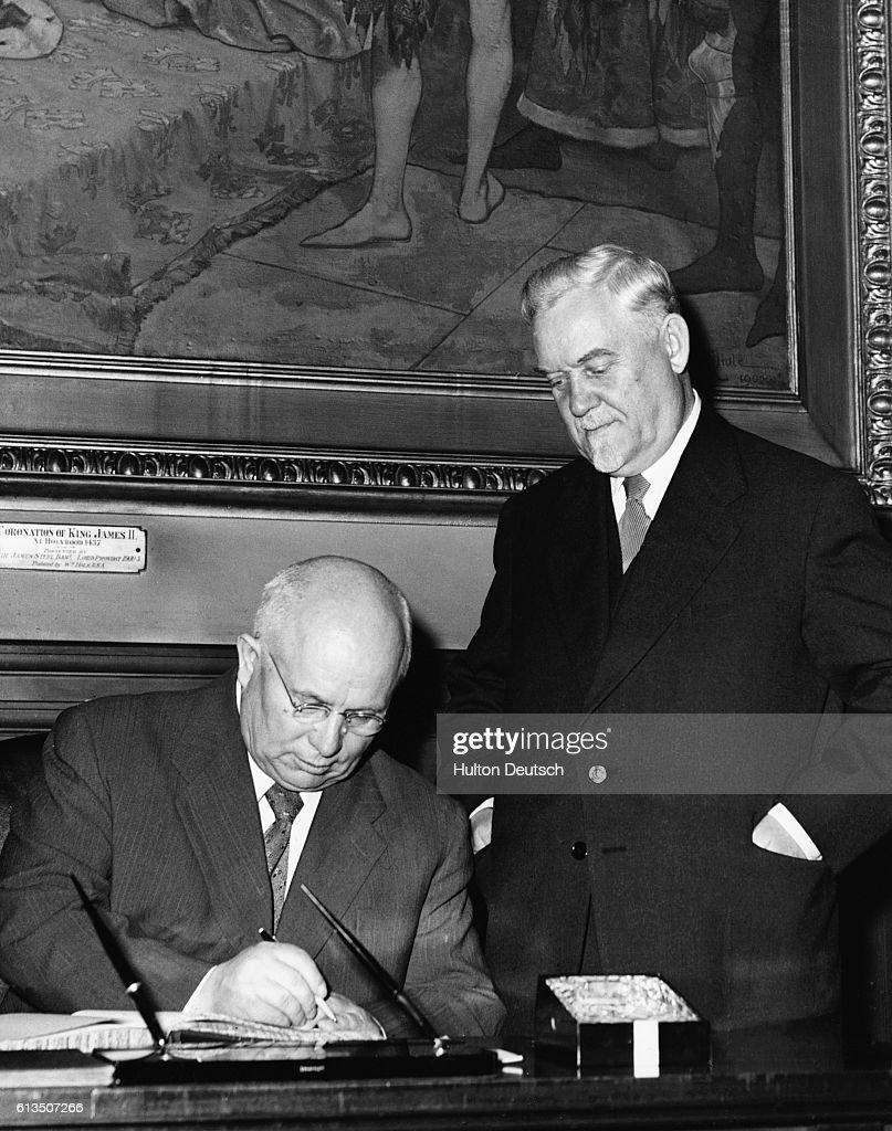 The Soviet leaders Nikolau Bulganin (r) and Niketa Khrushchev sign the visitors' book after a visit to Edinburgh's City Chambers.