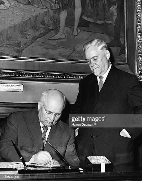 The Soviet leaders Nikolau Bulganin and Niketa Khrushchev sign the visitors' book after a visit to Edinburgh's City Chambers