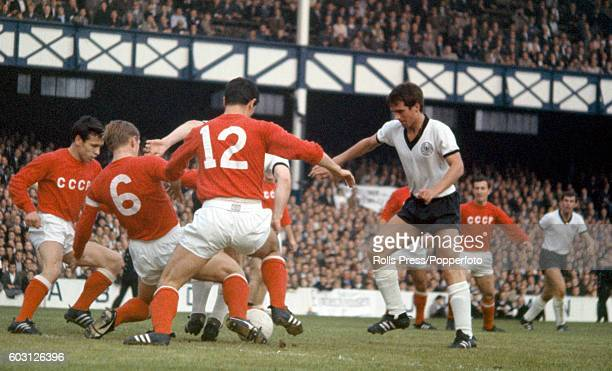 The Soviet Union defence including Albert Shesterniev and Valery Voronin create a red wall to thwart a German attack led by Uwe Seeler and Wolfgang...