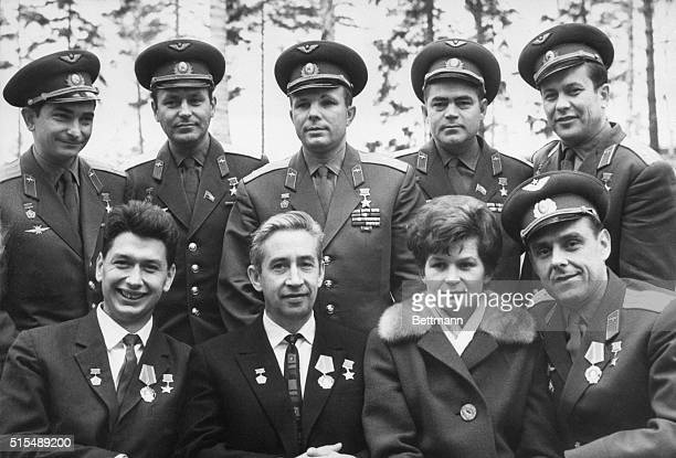 The Soviet Union's team of cosmonauts gather for a group portrait during their visit to Zvyezdniy a town near Moscow Rear left to right Valery...