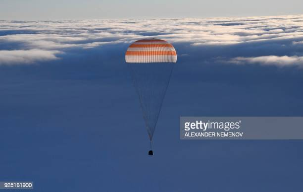 The Soyuz MS06 space capsule carrying the International Space Station crew of Russian cosmonaut Alexander Misurkin and NASA astronauts Mark Vande Hei...