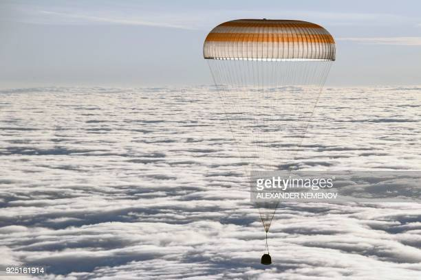 TOPSHOT The Soyuz MS06 space capsule carrying the International Space Station crew of Russian cosmonaut Alexander Misurkin and NASA astronauts Mark...