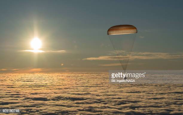 The Soyuz MS06 spacecraft is seen as it descends with Expedition 54 crew members Joe Acaba and Mark Vande Hei of NASA and cosmonaut Alexander...