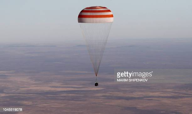 The Soyuz MS08 space capsule carrying the International Space Station crew of NASA astronauts Andrew Feustel and Richard Arnold and Roscosmos...
